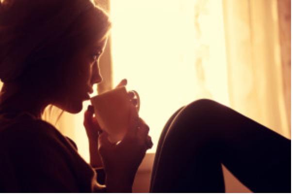 woman sensually drinking coffee